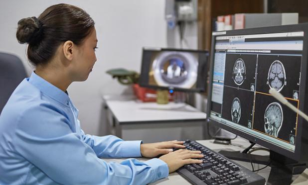 Radiologist looking at medical images on a computer