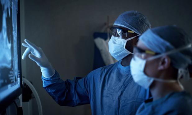 Surgeons looking at an X-ray image.